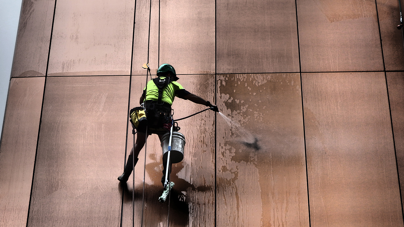 Rope Access Façade Cleaning - Commercial High Rise Window Cleaning - Magellan Company