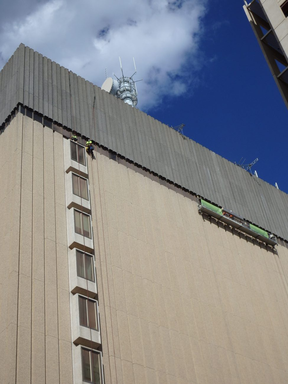 Workers Working On The Exterior Wall OF The Telstra Building - Cladding Sydney - Magellan Company